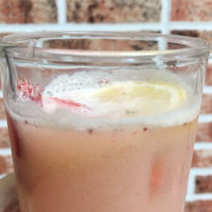 A pink drink made of strawberry, yakult, and lemon-lime soda.