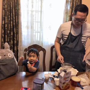 Father and son preparing the ingredients for cookies