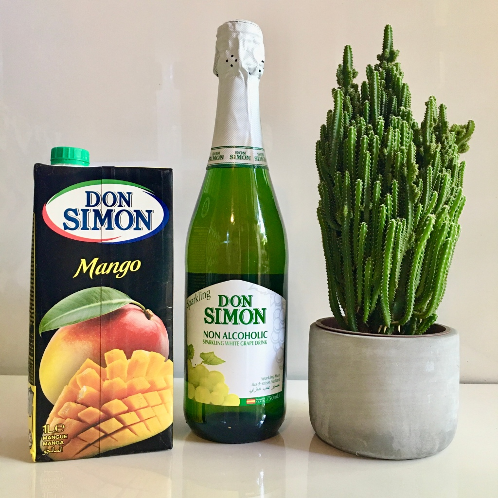 A bottle of Don Simon Sparkling White Grape Drink and Mango Juice