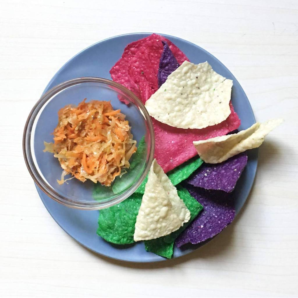 Colorful nacho chips with Curtido