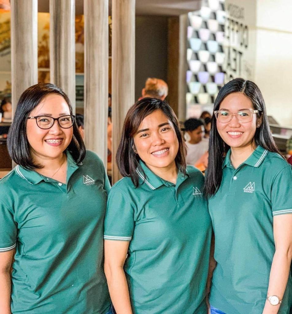 Three ladies smiling