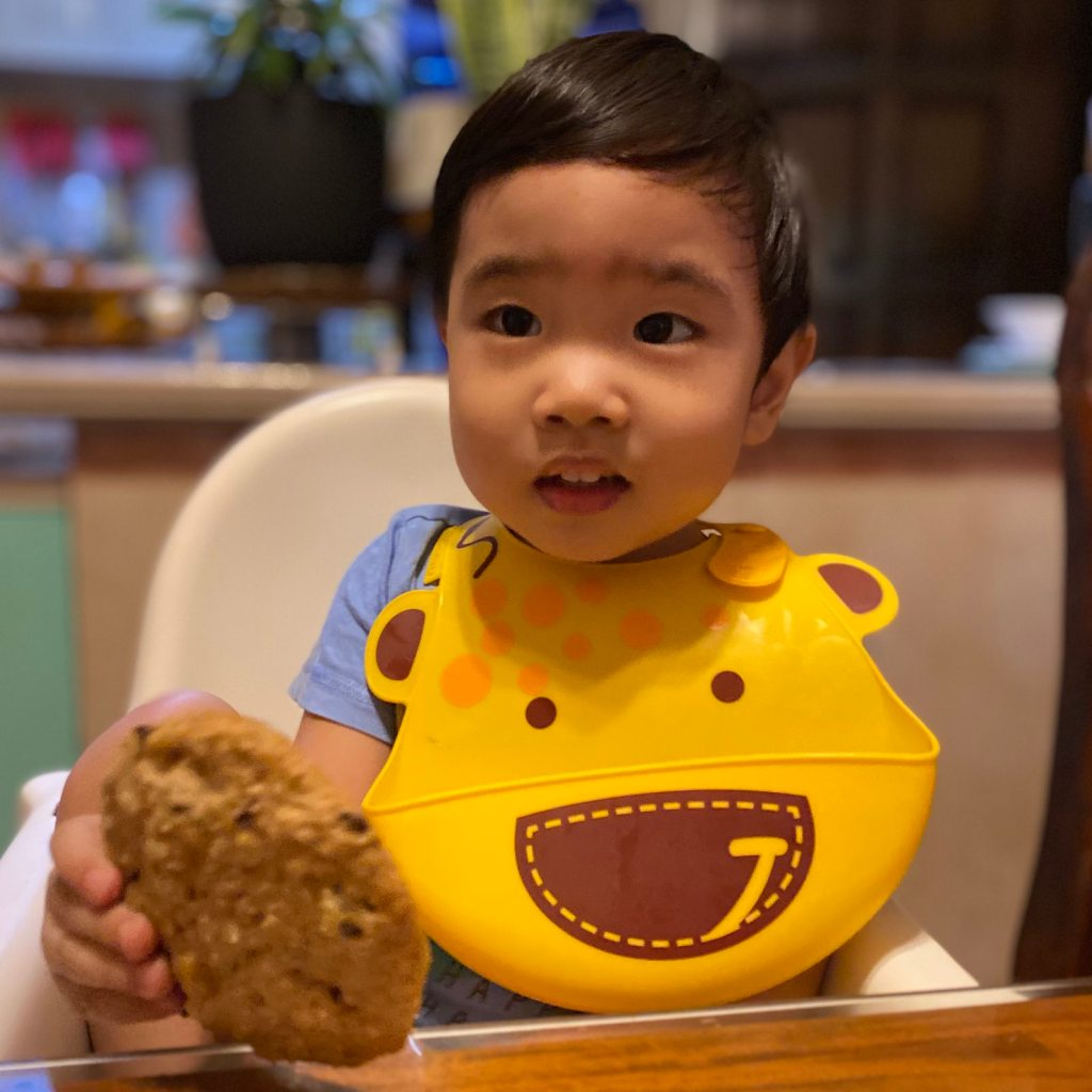 Toddler about to eat a cookie