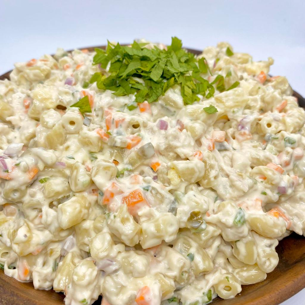 A mound of macaroni salad topped with chopped celery