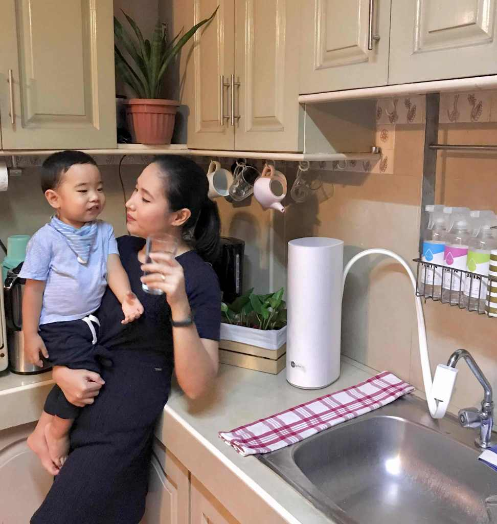 Mother and child drinking Ecosphere purified water