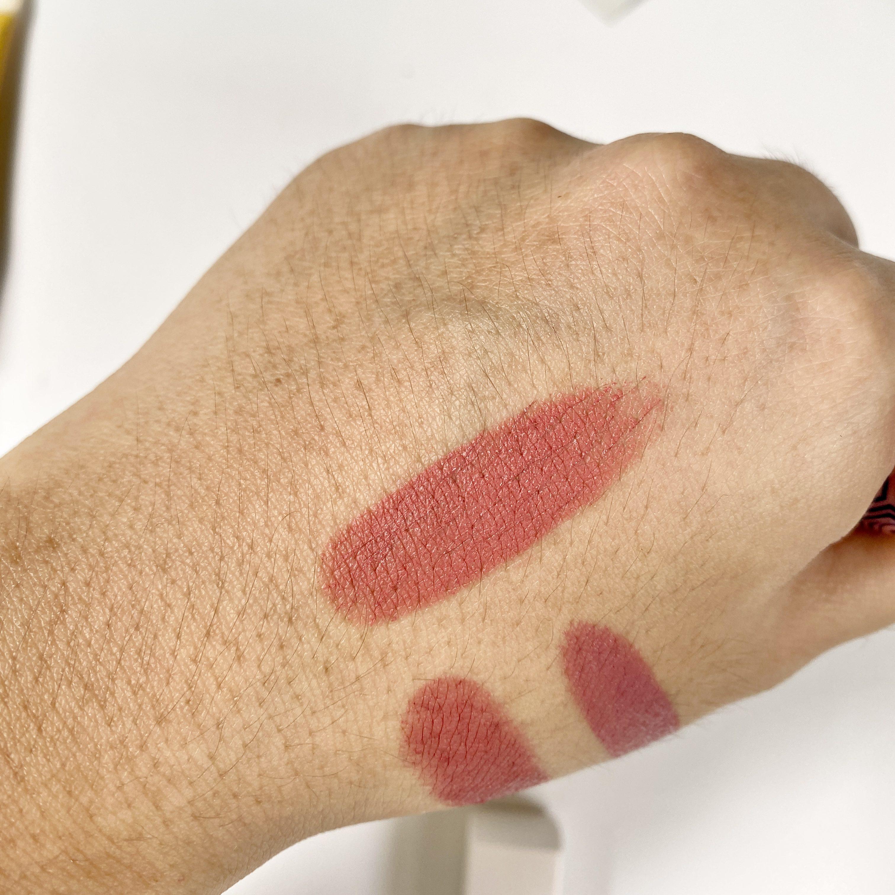 Swatching lipsticks on hand.
