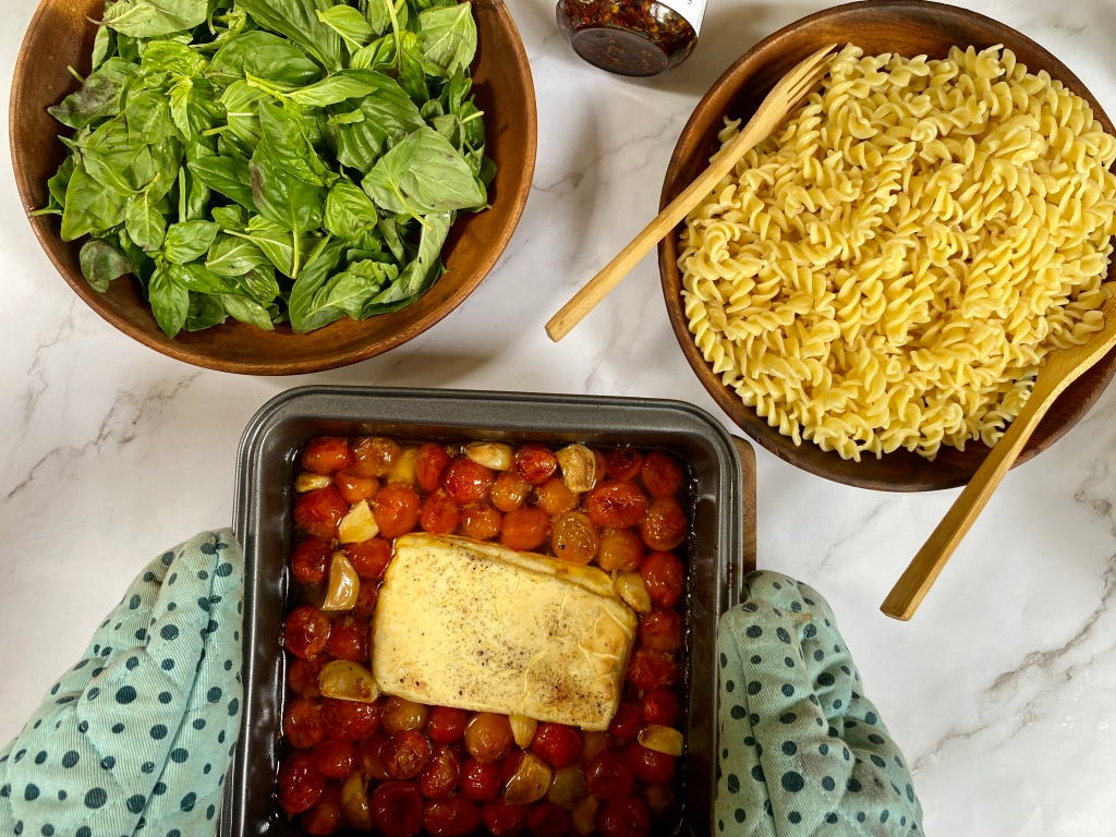 Assembling the viral tiktok baked feta pasta recipe