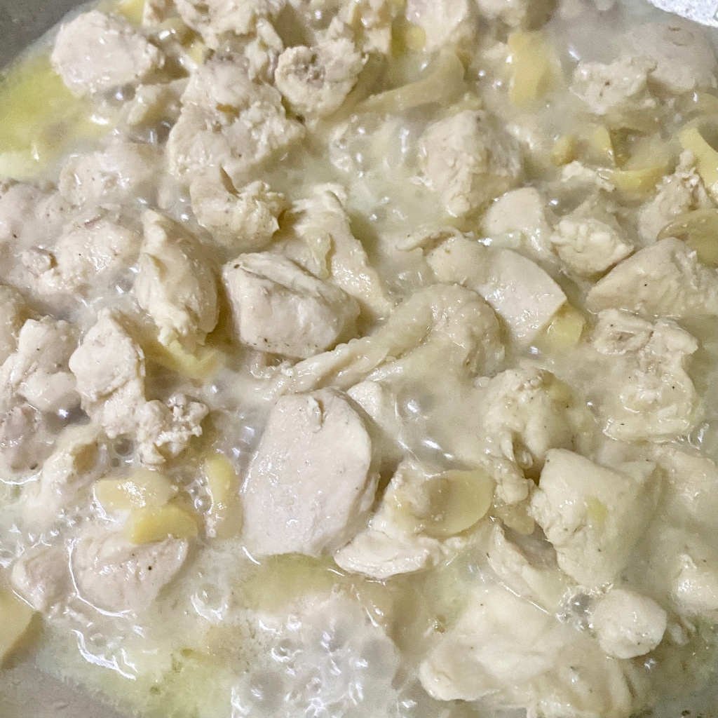 Simmering chicken and mushrooms in broth
