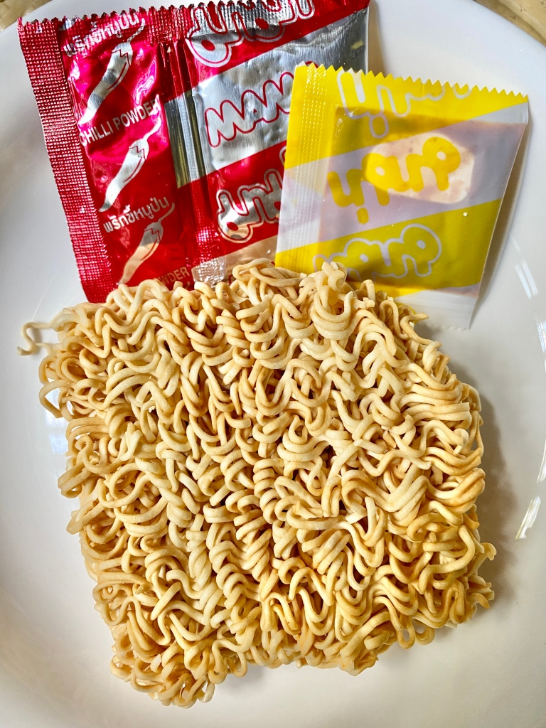 The contents of Mama instant tom yum noodles.
