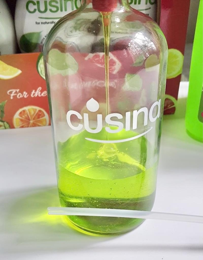 Transferring Cusina Home Dish Washing Liquid into a glass bottle.