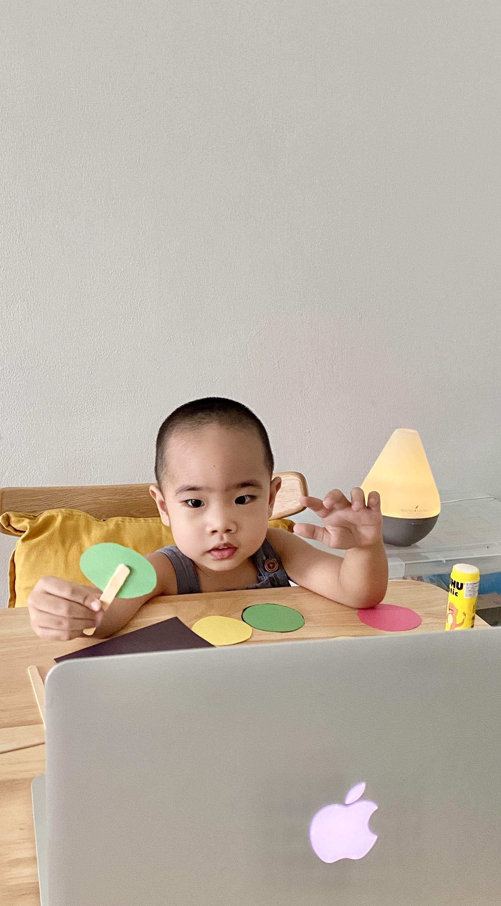 Toddler doing crafts for his online class